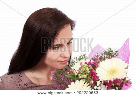 Portrait Of The Girl Of The Brunette In A Dress And Flowers