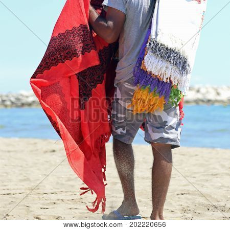 Old Peddler Sales Clothes On The Beach