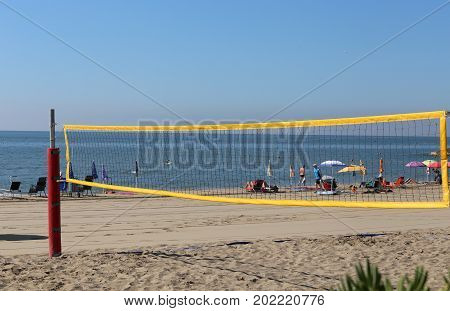 Net To Playing Beach Volley During Summer Vacation
