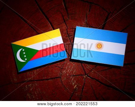 Comoros Flag With Argentinian Flag On A Tree Stump Isolated