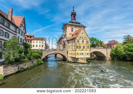Bamberg Germany - May 22 2016: Historical city hall of Bamberg on the bridge across the river Regnitz Bamberg Germany.