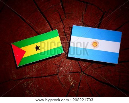 Sao Tome And Principe Flag With Argentinian Flag On A Tree Stump Isolated