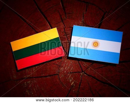 Lithuanian Flag With Argentinian Flag On A Tree Stump Isolated