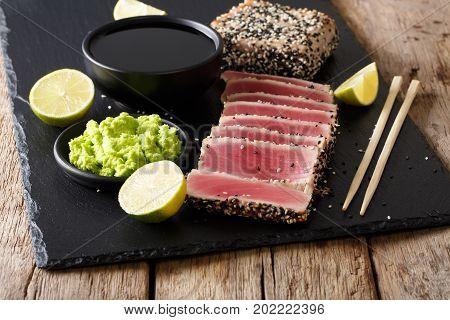 Sesame Seed Crusted Seared Tuna Served With Wasabi And Sauce Closeup. Horizontal