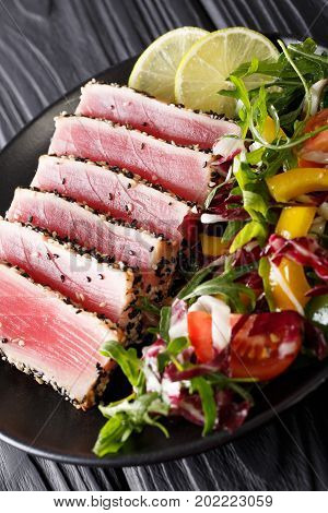 Close Up Of Rare Seared Ahi Tuna Slices With Fresh Vegetable Salad. Vertical