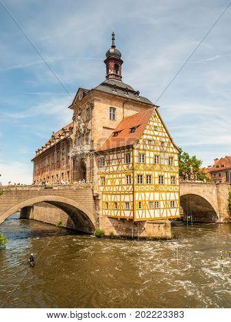 Bamberg Germany - May 22 2016: Historical city hall of Bamberg on the bridge across the river Regnitz Bamberg Germany.