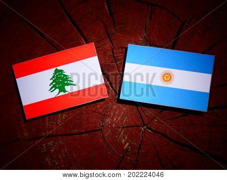 Lebanese Flag With Argentinian Flag On A Tree Stump Isolated