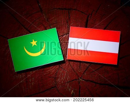 Mauritania Flag With Austrian Flag On A Tree Stump Isolated