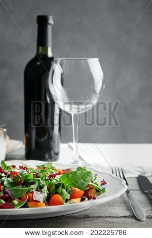 Plate with useful beet salad on table