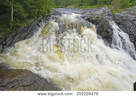 Roaring falls in the Wilderness of the Aux Sables River in Chutes Provincial Park in Ontario Canada