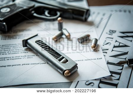 Ads on tracing criminals on the table of the hunter, combat pistol, cartridges