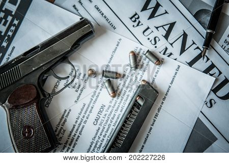 Ads on tracing criminals on the table of the bounty hunter, combat pistol, cartridges poster