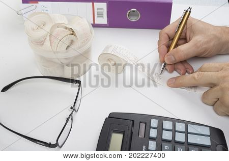 Salesman is checking receipts from cashier for the profit or loss