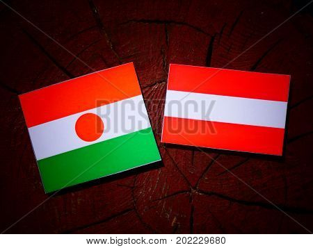 Niger Flag With Austrian Flag On A Tree Stump Isolated
