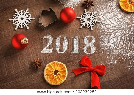 Cookie cutter, Christmas decor and 2018 made of flour on wooden table