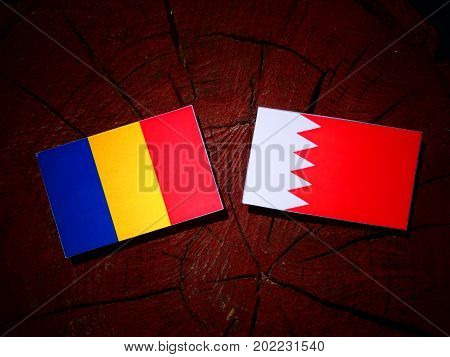 Chad Flag With Bahraini Flag On A Tree Stump Isolated