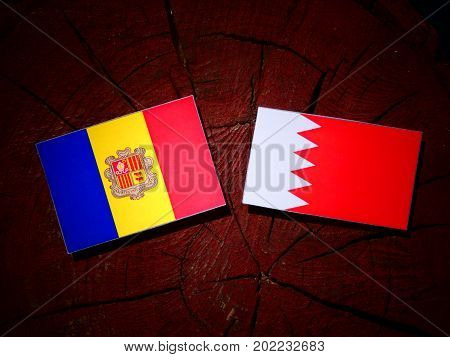 Andorra Flag With Bahraini Flag On A Tree Stump Isolated