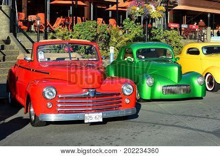Victoria BC,Canada,July 24th 2016.Classic cars lined up on the street at the annual car show in Victoria BC.