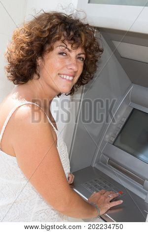 A Young Woman Looking Happy At The Cash Machine