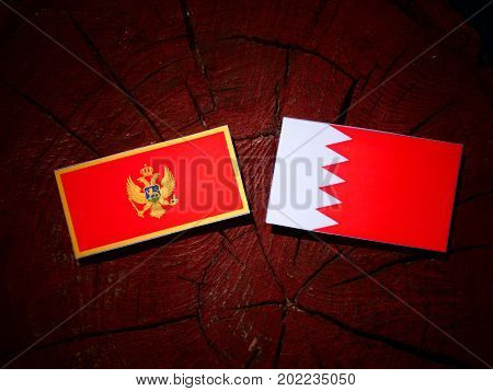 Montenegrin Flag With Bahraini Flag On A Tree Stump Isolated