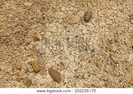 dry earth with cracks and stones earth cracked because of drought