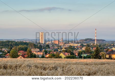Summer urban landscape. View from the hill to the houses and coalmine.
