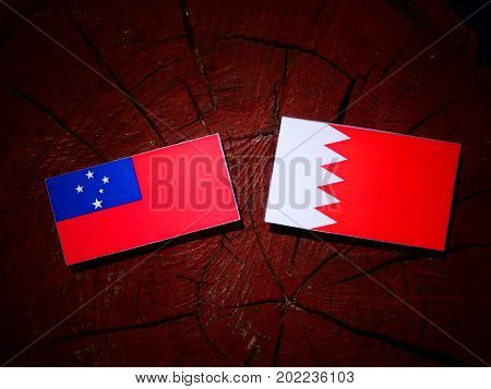 Samoa Flag With Bahraini Flag On A Tree Stump Isolated