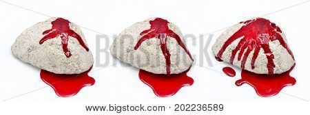 Stone with blood on white background close up