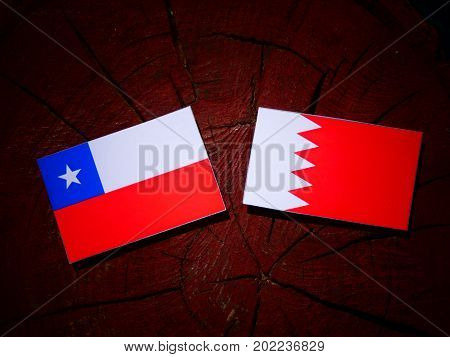 Chilean Flag With Bahraini Flag On A Tree Stump Isolated