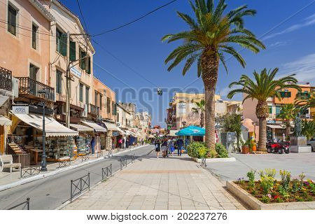 CHANIA, GREECE - APRIL 3, 2017 : Narrow streets with souvenirs in Venetian port of Chania on Crete, Greece. Chania is the second largest city of Crete and the capital of the Chania regional unit.
