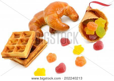 Croissants waffles and marmalade isolated on white background