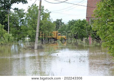 The consequences of flooding flooded house with truck