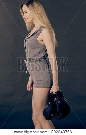 Boxer Girl Holding Boxing Gloves.