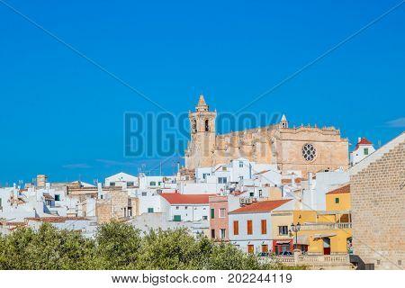 Ciutadella town cityscape with Basilica of Ciutadella de Menorca cathedral among historical center buildings, Menorca island, Spain.