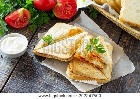 Pressed And Toasted Double Sandwich With Chicken, Korean Carrots, Cheese And Tomatoes, Served On A S
