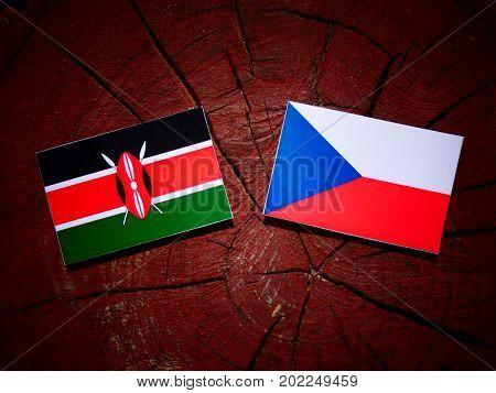 Kenyan Flag With Czech Flag On A Tree Stump Isolated