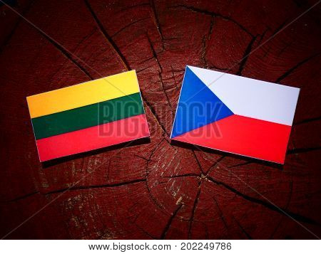 Lithuanian Flag With Czech Flag On A Tree Stump Isolated