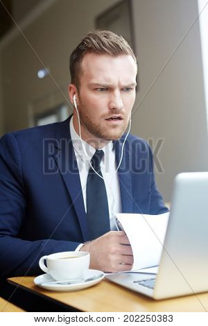 Confident employer speaking to one of applicants through video-chat