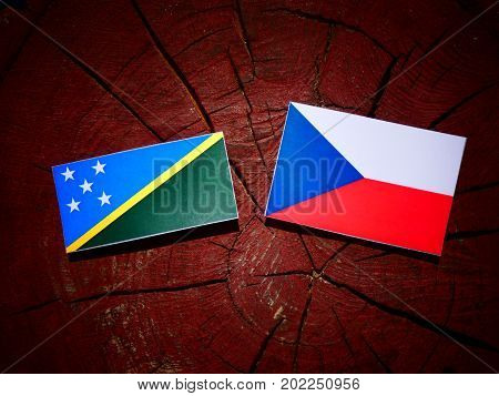 Solomon Islands Flag With Czech Flag On A Tree Stump Isolated
