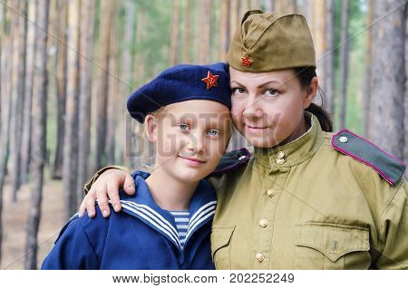 Reconstruction of the events of World war II, Russia, Dimitrovgrad, 26 Aug 2017. Portrait of a man and a little girl in the uniform of the red Army.