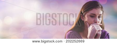 Digital composite of Thinking and worried woman with sparkling light bokeh transition