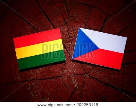 Bolivian Flag With Czech Flag On A Tree Stump Isolated