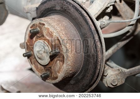 old broken rusty brake disc on an old car