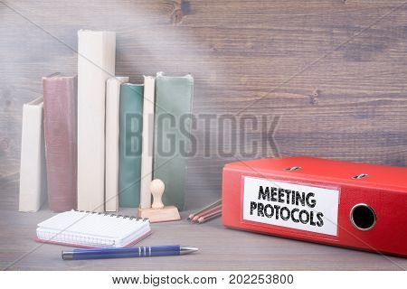 Meeting Protocols. Binder on desk in the office. Business background.