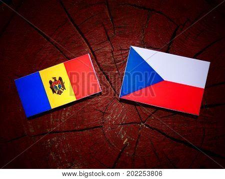Moldovan Flag With Czech Flag On A Tree Stump Isolated