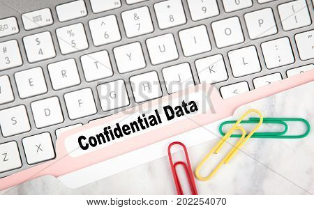 Confidential Data concept. Folder Register on a white computer keyboard.
