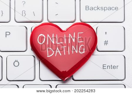 Closeup of red heart on keyboard representing online dating