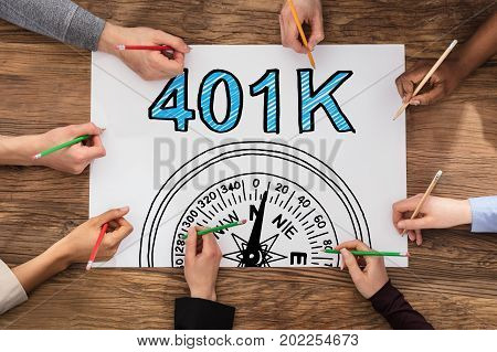 High Angle View Of Group Of People Drawing 401k Pension Plan