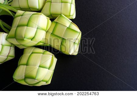 Rice Dumpling Casing Or Also Know As Ketupat Made From Coconut Palm Leaf On Black Background. Ketupa