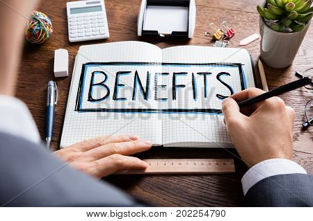 Social Man Drawing Social Security Benefits In Notepad